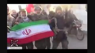 پرچم ایران اسلامی در دست مدافعان حرم در نبل و الزهرا